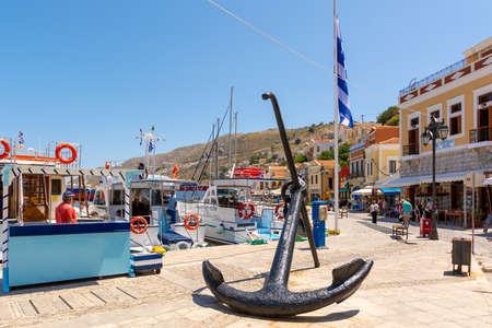 SYMI, GREECE - May 15, 2018: Anchor on seaside promenade on Symi island, Dodecanese, Greece Editorial