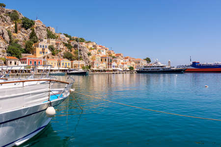 Beautiful Symi island with sea bay and colorful architecture, Dodecanese, Greece Standard-Bild