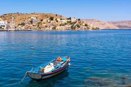 The beautiful island of Symi with a turquoise bay. Dodecanese, Greece Standard-Bild
