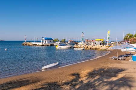 Sandy beach next to the Faliraki harbor on Rhodes island, Greece Standard-Bild