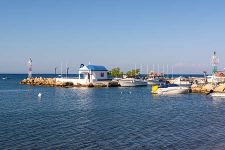 Traditional Greek church in Faliraki harbor on Rhodes island, Greece