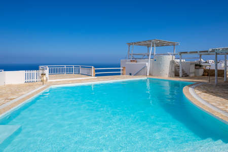 Folegandros, Greece - September 25, 2020: Holiday hotel with swimming pool, a typical Cycladic architecture on the Island of Folegandros. Greece Editorial