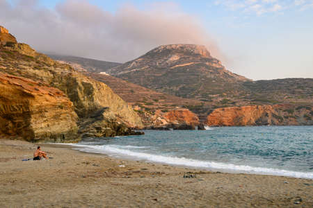 Folegandros, Greece - September 24, 2020: A tourists relaxing on the Agali beach. Folegandros island. Cyclades, Greece
