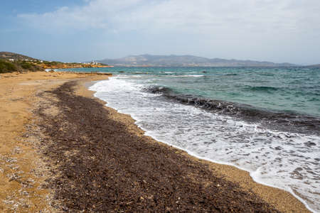 Soros beach on Antiparos Island. A wonderful beach with the golden sand and azure waters. Cyclades, Greece