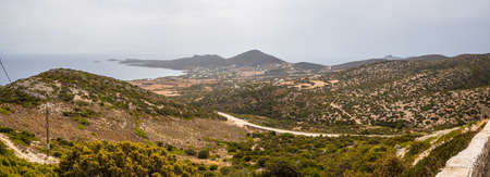 Panoramic view of south coast of Antiparos Island. The road among the hills. Cyclades islands, Greece