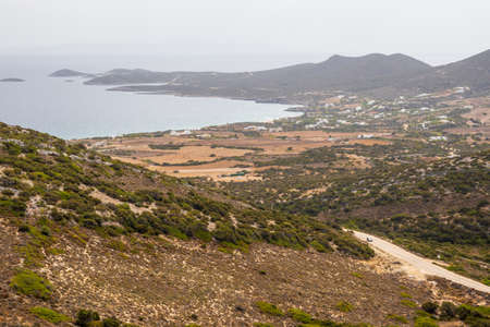 South coast of Antiparos Island. White houses situated in the valley. Cyclades islands, Greece