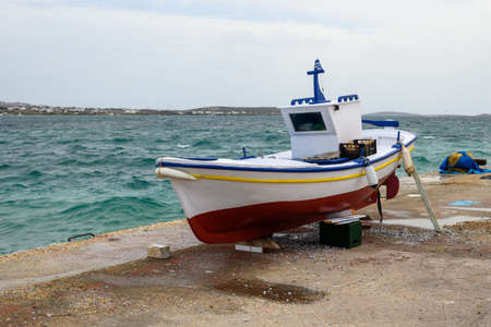 Boat during the renovation at Antiparos harbor. View of the Aegean Sea, Cyclades, Greece