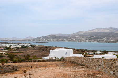 The beautiful coast of Antiparos Island with a white Greek houses. Cyclades, Greece