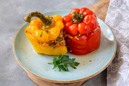 Pepper stuffed with minced meat and rice in tomato sauce.
