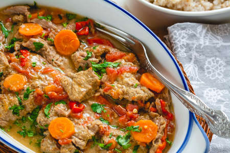 Beef stew in gravy with vegetables. Meat goulash Standard-Bild