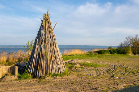 Wooden teepee (or tipi) on the shore of the Vistula Lagoon, Northern Poland