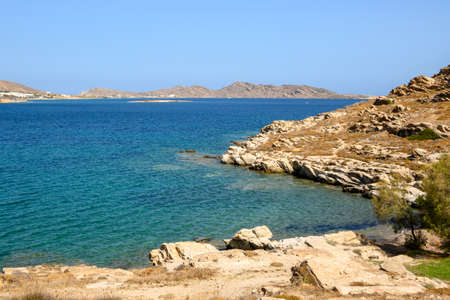 Beautiful bay with blue crystal waters in Naoussa village. Paros island, Greece