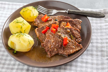 Homemade braised beef with gravy and potatoes