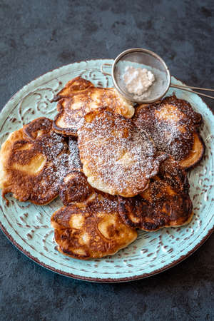 Racuchy - traditional Polish yeast pancakes dusted with icing sugar