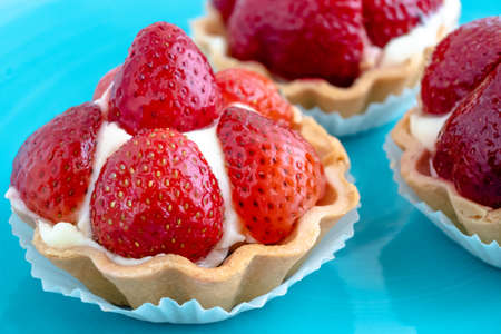 Tartlets with strawberries and cream. Dessert with fresh fruits.