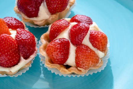 Strawberry tartlets with cream. Dessert with fresh fruits