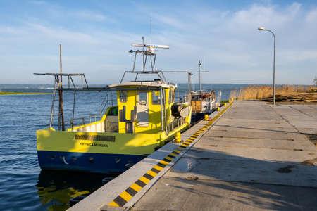 Krynica Morska, Poland - May 15, 2021: The wharf in the fishing port in Krynica Morska on Vistula Spit. Baltic Sea