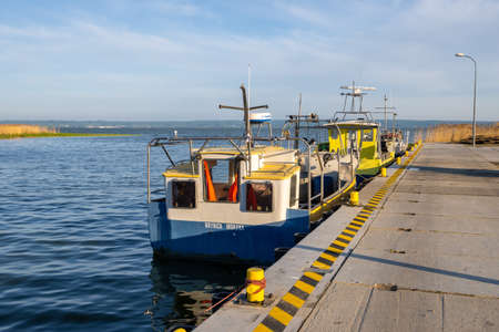 Krynica Morska, Poland - May 15, 2021: Fishing boats docked in port of Krynica Morska on Vistula Spit. Baltic Sea