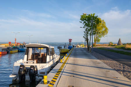 Krynica Morska, Poland - May 15, 2021: Fishing boat docked in port of Krynica Morska on Vistula Spit. Baltic Sea Editorial