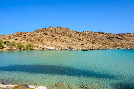 Monastiri beach in the Agios Ioannis Bay with turquoise and crystal water. Paros island, Cyclades, Greece