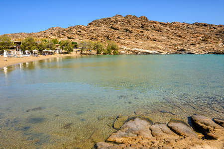 Monastiri Beach (the beach of the monastery of Agios Ioannis) located in a small rocky bay surrounded by rocky hills. Paros island, Cyclades, Greece Standard-Bild