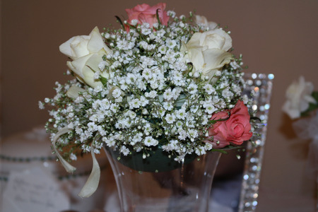 floral decoration: BABYS BREATH AND ROSES