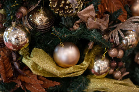 Decorated brown Christmas tree, sparkling and fairy background with color ball Stock Photo