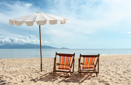 parasol: Chairs on  the beach near with sea Stock Photo
