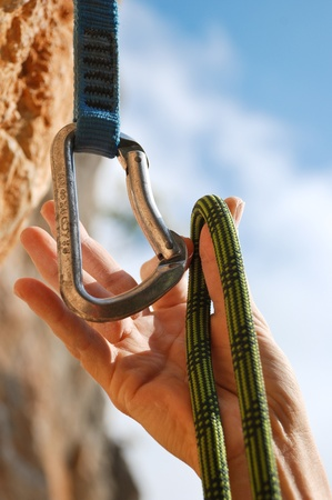 rock climb: Extreme sport. A climbers rope and quick-draws