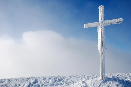 Cross on the mountain peak photo