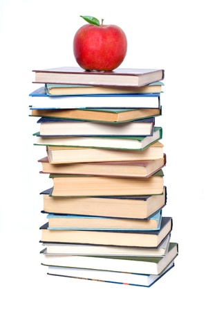 School and Education. Books tower with apple isolated on white photo