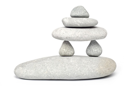 Abstract. Stone towers isolated on white background photo