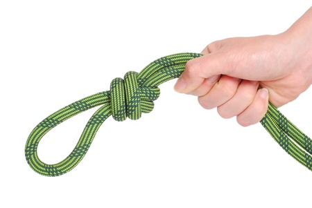 Climbing knot and hand isolated on white Stock Photo - 10507541
