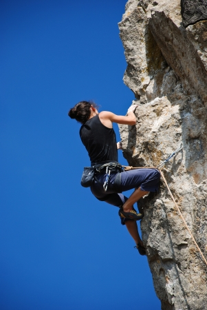 Extreme sport. The rock-climber during rock conquest photo