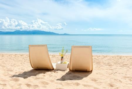 Chairs on  the beach near with sea Standard-Bild