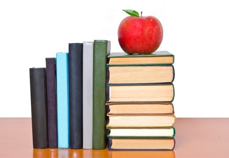 bookshop: School and Education. Books tower with apple isolated on white