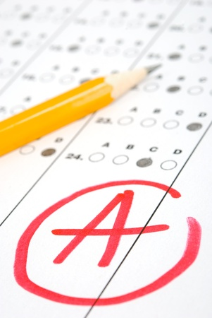 grades: Test score sheet with answers and pencil Stock Photo