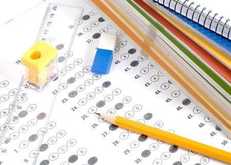 education choice: Test with pencil, notebook and eraser Stock Photo