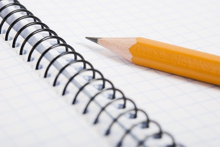 Education and objects. Blank notebook with pencil photo