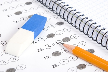 Test with pencil, notebook and eraser Standard-Bild