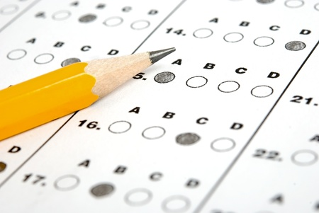eraser mark: Test score sheet with answers and pencil Stock Photo