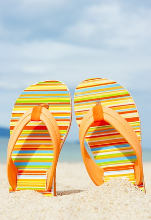 sandy feet: Beach sandal on the sandy coast