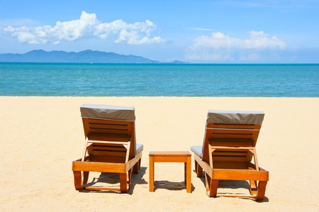 Chairs on the beautiful sandy beach near sea
