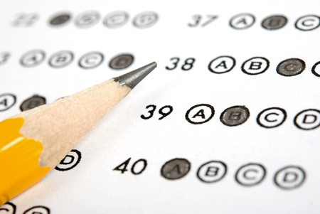 Test score sheet with answers and pencil photo