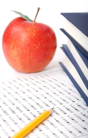 eraser mark: Education. Test score sheet with apple and books
