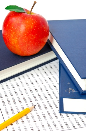 Education. Test score sheet with apple and books Stock Photo - 11575665