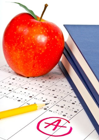 Education. Test score sheet with apple and books