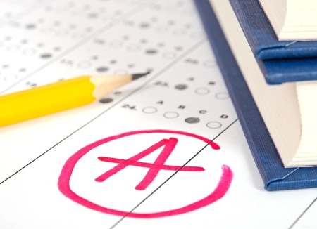 academic symbol: School and Education. Test paper with result