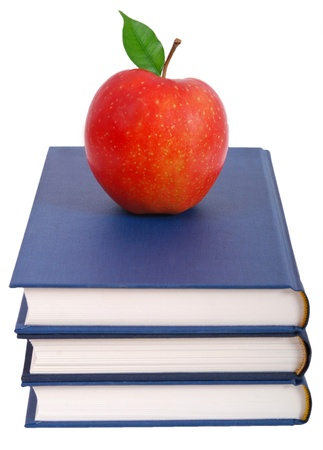 hardcover book: Books tower with apple isolated on white background