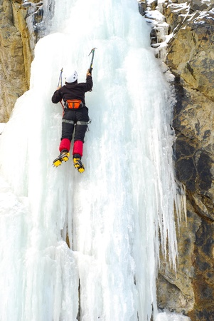 ice axe: Extreme Sport. Climbing on a frozen waterfall Stock Photo